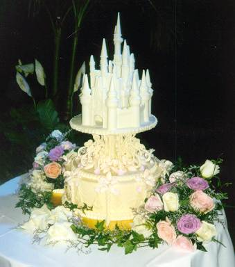 The wedding cake was gorgeous topped with a replica of Cinderella 39s castle